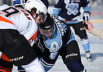 OMAHA, NE - FEBRUARY 9:  Connor Chatham #9 from the Omaha Lancers and Eric Scheid #39 from the Lincoln Stars wait for the puck to drop on a face off in the second period at the Battle on Ice Saturday at TD Ameritrade in Omaha, NE. (Photo by Dave Eggen/Inertia)