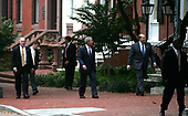 Just a walk in the park -- United States President George W. Bush, surrounded by Secret Service agents, walks by Lafayette Park in front of the White House in Washington, DC to a Republican Governors Association reception at Decatur House on October 22, 2007. <br /> Credit: Dennis Brack / Pool via CNP