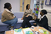 A group of black women chatting at Nottingham's 'Women's Enterprise Day' exhibition; held at the New Deal for Communities centre,