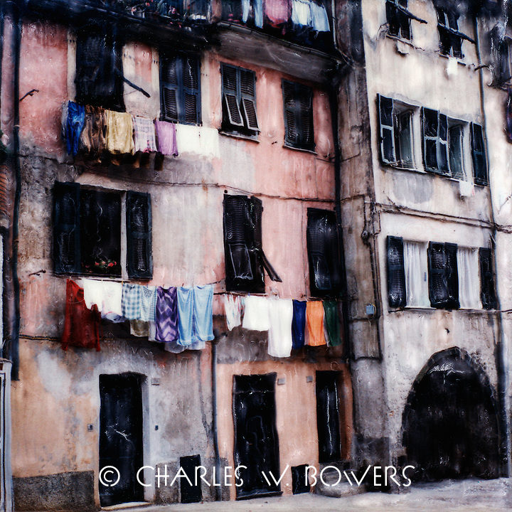 Cinque Terra residence hang their laundry from their balconies and clothes lines against their homes.<br />
