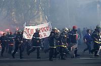 Firemen marching in a demonstration in December 1995, along Castellane Plaza, Marseille, France.