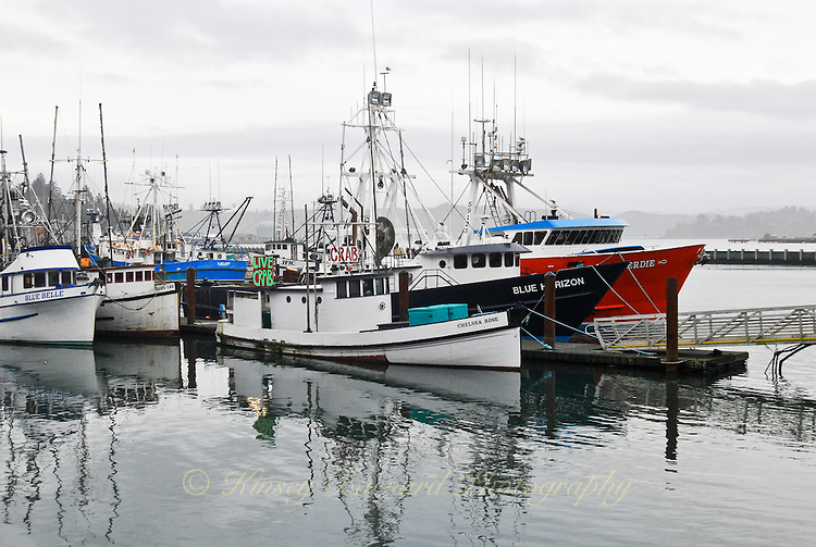 colorful fishing fleet at newport harbor on a grey winter day