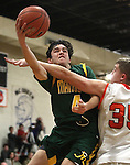 Douglas' Hunter Myers fouls Manogue's James Sandoval during the boys varsity basketball game at DHS on Tuesday, Jan. 15, 2013. Douglas won 68-49..Photo by Cathleen Allison