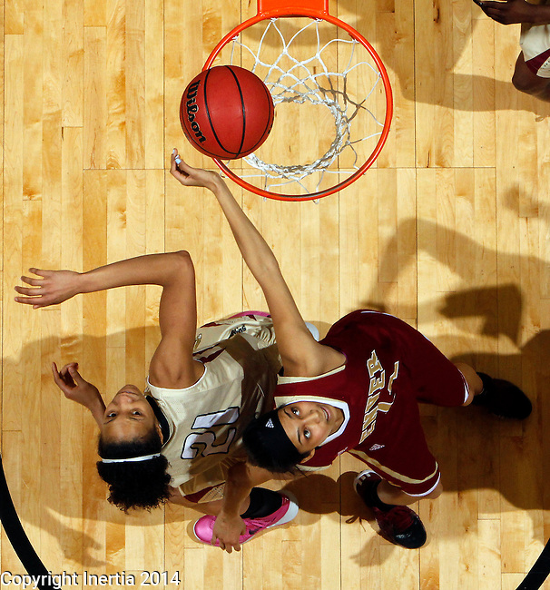 SIOUX FALLS, SD - MARCH 10:  Shanika Maddox #21 from IUPUI battles for position with Kailey Edwards #14 from Denver in the second half of their semifinal game at the 2014 Summit League Basketball Championships Monday at the Sioux Falls Arena(Photo by Dave Eggen/Inertia)