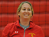Coach Emily Butler of Sacred Heart Academy smiles as her team warms up before a CHSAA varsity girls volleyball match against host St. John the Baptist High School in West Islip on Thursday, Oct. 12, 2017.