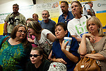 Evacuees from the town of Yarnell listen to an update on the fire that claimed 19 firefighters from authorities in Prescott, Arizona, July 2, 2013.