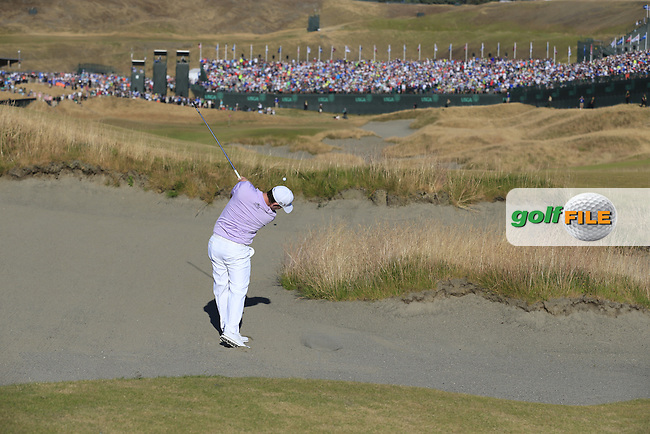 Branden GRACE (RSA) plays his 2nd shot from the sand on the 18th hole during Sunday's Final Round of the 2015 U.S. Open 115th National Championship held at Chambers Bay, Seattle, Washington, USA. 6/22/2015.<br /> Picture: Golffile | Eoin Clarke<br /> <br /> <br /> <br /> <br /> All photo usage must carry mandatory copyright credit (&copy; Golffile | Eoin Clarke)