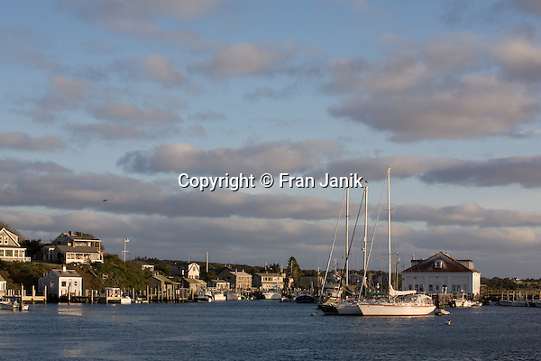 A view of Menemsha Harbor on the lsland of Martha's Vineyard.  The Island is located off the coast of Massachusetts, to the south of Cape Cod. Settled by the English in 1642, it became an important center of fishing and whailing during the 18th and 19th centuries. the The Harbor is seen on an October day at sunset.