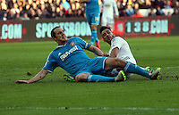 SWANSEA, WALES - FEBRUARY 07: Neil Taylor of Swansea (R) loses the ball to John O'Shea of Sunderland (L) during the Premier League match between Swansea City and Sunderland AFC at Liberty Stadium on February 7, 2015 in Swansea, Wales.