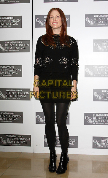 "JULIANNE MOORE.Photocall for ""Chloe"" during The Times BFI London Film Festival at Mayfair Hotel, London, England. .October 22nd, 2009.LFF full length black dress tights ankle boots crochet cut out away.CAP/JIL.©Jill Mayhew/Capital Pictures"