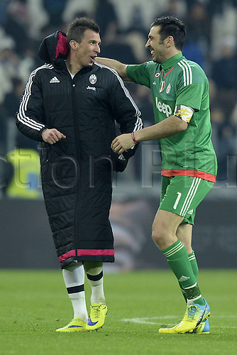 12.03.2016. Turin Italy. Goalie Gianluigi Buffon of Juventus, who broke the clean-sheet record reacts with Mario Mandzukic after the Italian Serie A soccer match between Juventus and Sassuolo at Juventus Stadium in Turin, Italy, March 11, 2016. Juventus won 1-0.