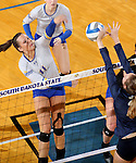 BROOKINGS, SD - OCTOBER 28:  Ashley Beaner #11 from South Dakota State gets a kill past an Oral Roberts defender Friday night at Frost Arena in Brookings. (Photo by Dave Eggen/Inertia)
