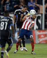Ramiro Corrales of Earthquakes fights for the ball in the air against Tristan Bowen of Chivas USA during the second half of the game at Buck Shaw Stadium in Santa Clara, California on September 2nd, 2012.   San Jose Earthquakes defeated Chivas USA, 4-0.