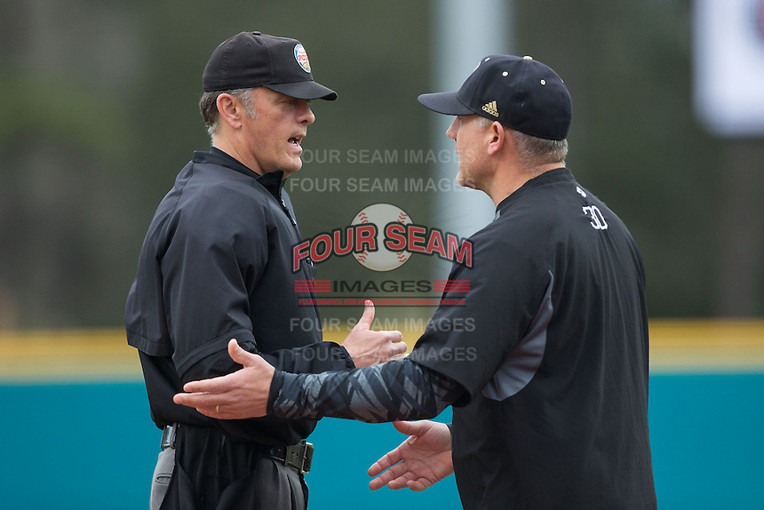 Bryant Bulldogs head coach Steve Owens (30) argues a call with home plate umpire Todd Drake during the game against the Coastal Carolina Chanticleers at Springs Brooks Stadium on March 13, 2015 in Charlotte, North Carolina.  The Chanticleers defeated the Bulldogs 7-2.  (Brian Westerholt/Four Seam Images)