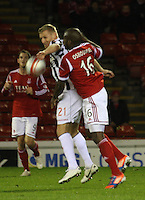 Gary Teale and Isaac Osbourne challenge in the Aberdeen v St Mirren Scottish Communities League Cup match played at Pittodrie Stadium, Aberdeen on 30.10.12.