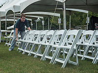 NWA Democrat-Gazette/SPENCER TIREY    Christina Maples the employee coordinator at Life Styles sets up chairs with others Friday, Sept. 7, 2018, at Buell Farm in preparation for Polo in the Ozarks an annual fundraiser for Life Styles.  Life Styles is an organization that supports individuals with disabilities. Tickets are still available to watch the polo match and enjoy for the event for $25 at the gate.  to see more information you can go to lifestylesinc.org.