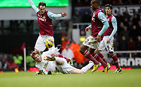 Barclays Premier League, West Ham United (red)V Swansea City Fc (white), Boelyn Ground, 02/02/13<br /> Pictured: Even from the ground Michu isn't scared to have a go  at goal<br /> Picture by: Ben Wyeth / Athena Picture Agency<br /> info@athena-pictures.com