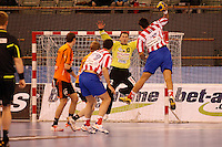 25.03.2012 MADRID, SPAIN -  EHF Champions League match played between BM At. Madrid vs Kadetten Schaffhausen (26-30) at Palacio Vistalegre stadium. the picture show Arunas Vaskevicius (Kadetten Schaffhausen player) and  Edu Fernandez (BM Atletico de Madrid)