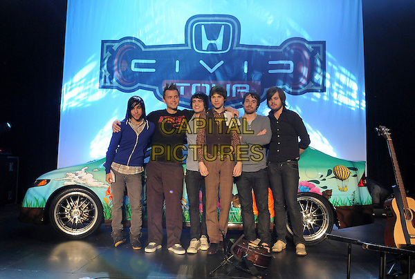 PETE WENTS (FALL OUT BOY), MARK HOPPUS (+44), & PANIC AT THE DISCO (BRENDON URIE, RYAN ROSS, SPENCER SMITH & JON WALKER.The 2008 Honda Civic Tour Launch Announcement held at The Honda Plant in Torrance, California, USA. .January 10th, 2008                                                                                        full length car arms over shoulder jeans denim blue hoodie hooded top brown vest waistcoat black shirt.CAP/DVS.©Debbie VanStory/Capital Pictures