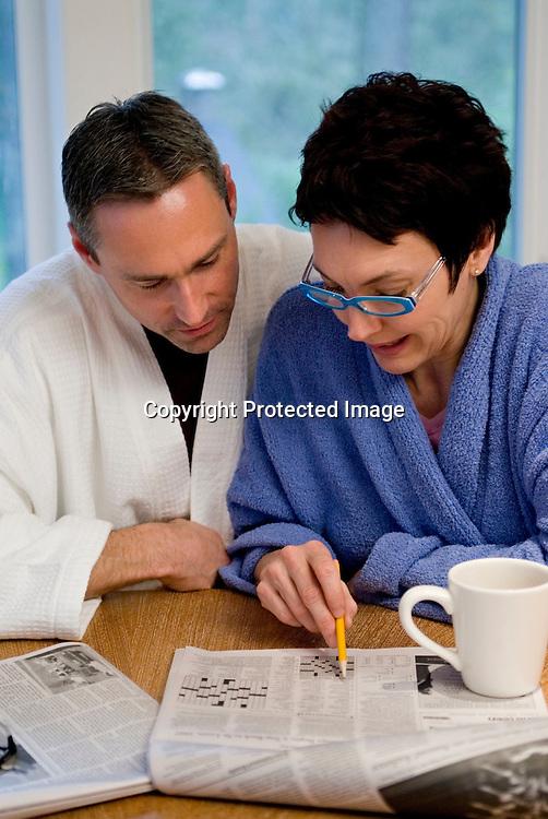 Mature couple solving crossword