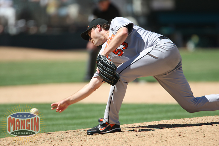 OAKLAND, CA - July 22:  Chad Bradford of the Baltimore Orioles pitches during the game against the Oakland Athletics at the McAfee Coliseum in Oakland, California on July 22, 2007.  The Orioles defeated the Athletics 2-0.  Photo by Brad Mangin