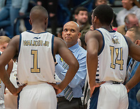 WASHINGTON, DC - NOVEMBER 16: Coach Jamion Christian of George Washington talks to Shawn Walker Jr. #1 and Maceo Jack #14 during a game between Morgan State University and George Washington University at The Smith Center on November 16, 2019 in Washington, DC.