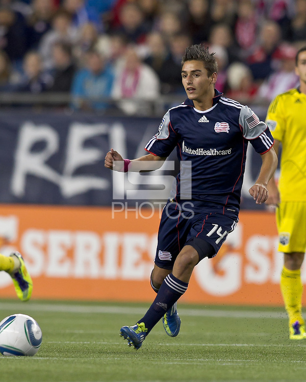 New England Revolution forward Diego Fagundez (14) passes the ball.  In a Major League Soccer (MLS) match, the Columbus Crew defeated the New England Revolution, 3-0, at Gillette Stadium on October 15, 2011.