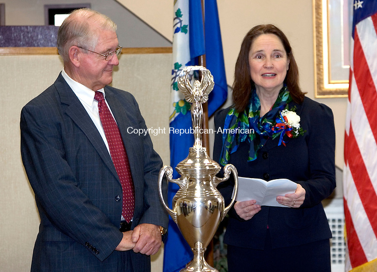 MIDDLEBURY, CT. 14 February 2012-021412SV01-First Selectman Edward St. John receives the Democracy Cup from Secretary of the State Denise Merrill during a presentation at Town Hall in Middlebury Tuesday. The cup was presented to the town for high voter turnout in the 2011 election. Middlebury had 52 percent of their voter's turnout for the election. They had the highest turnout among mid size towns across the state..Steven Valenti Republican-American