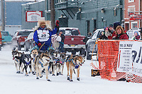 Karin Hendrickson runs into the finish chute at Nome on Thursday March 13 during the 2014 Iditarod Sled Dog Race.<br /> <br /> PHOTO (c) BY JEFF SCHULTZ/IditarodPhotos.com -- REPRODUCTION PROHIBITED WITHOUT PERMISSION