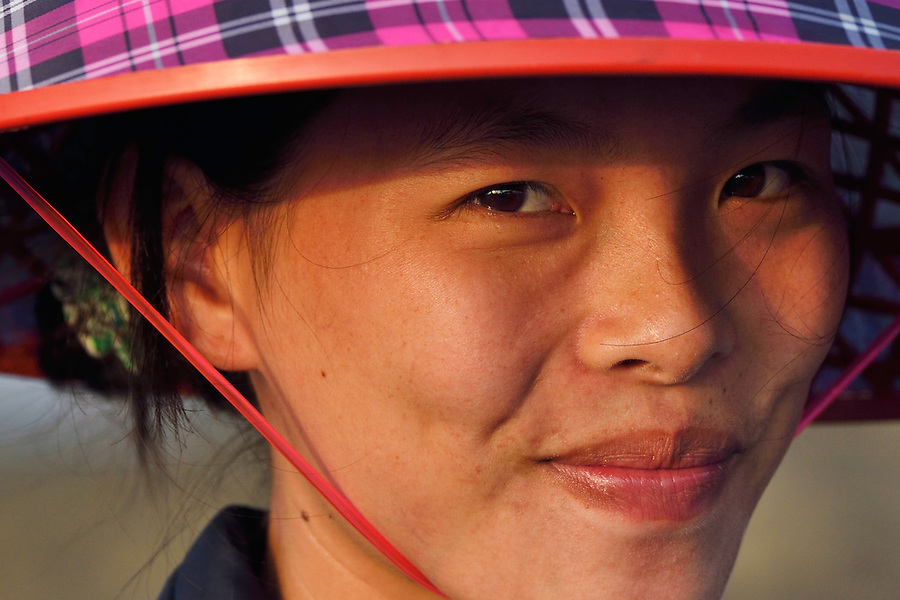 Young woman at the fish collection point, Shi Ma Jiao harbour, Guangdong province, China