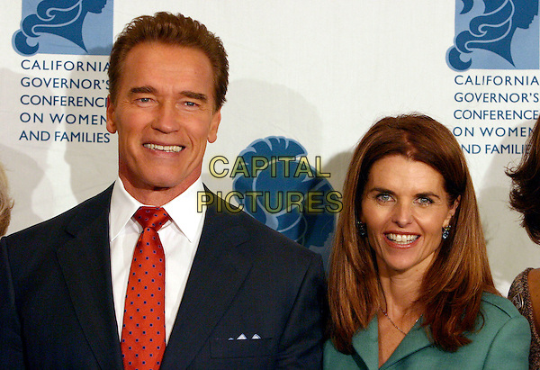 ARNOLD SCHWARZENEGGER & MARIA SHRIVER.The California Governor's Conference on Women and Families held at the Long Beach Convention Centre, Long Beach, California, 07 December 2004..portrait headshot arnie married husband wife schriver.Ref: ADM.www.capitalpictures.com.sales@capitalpictures.com.©Zach Lipp/AdMedia/Capital Pictures .