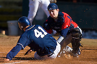 Brett Huffman #41 of the Catawba Indians is tagged out at home plate by Steve Sulcoski #17 of the Shippensburg Red Raiders on February 14, 2010 in Salisbury, North Carolina.  Photo by Brian Westerholt / Four Seam Images