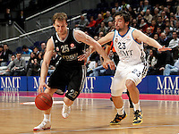 Real Madrid's Sergio Llull and Brose's Anton Gavel during Euroliga match. February 28,2013.(ALTERPHOTOS/Alconada)