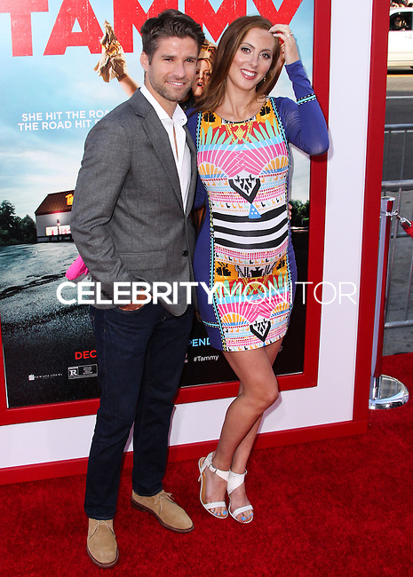 """HOLLYWOOD, LOS ANGELES, CA, USA - JUNE 30: Actress Eva Amurri Martino (L) and husband Kyle Martino (R) arrive at the Los Angeles Premiere Of Warner Bros. Pictures' """"Tammy"""" held at the TCL Chinese Theatre on June 30, 2014 in Hollywood, Los Angeles, California, United States. (Photo by Xavier Collin/Celebrity Monitor)"""