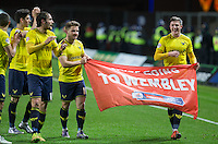The Oxford United players celebrate victory during the Johnstone's Paint Trophy Southern Final 2nd Leg match between Oxford United and Millwall at the Kassam Stadium, Oxford, England on 2 February 2016. Photo by Andy Rowland / PRiME Media Images.