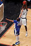 Connecticut forward Denham Brown (33) shoots over Kentucky guard Patrick Sparks (22).  Connecticut defeated Kentucky 87-83 in the second round of the NCAA Tournament  at the Wachovia Center in Philadelphia, Pennsylvania on March 19, 2006.