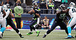 Seattle Seahawks  quarterback Russell Wilson looks to pass against the Carolina Panthers  at CenturyLink Field in Seattle on October 18, 2015. The Panthers came from behind with 32 seconds remaining in the 4th Quarter to beat the Seahawks 27-23.  ©2015 Jim Bryant Photography. All Rights Reserved.