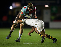 Harlequins' James Chisholm is tackled by Wasps' Kyle Eastmond<br /> <br /> Photographer Bob Bradford/CameraSport<br /> <br /> European Rugby Challenge Cup - Harlequins v Wasps - Sunday 13th January 2018 - Twickenham Stoop - London<br /> <br /> World Copyright &copy; 2018 CameraSport. All rights reserved. 43 Linden Ave. Countesthorpe. Leicester. England. LE8 5PG - Tel: +44 (0) 116 277 4147 - admin@camerasport.com - www.camerasport.com