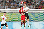 10 August 2008: Gao Lin (CHN) (9) and Thomas Vermaelen (BEL) (4) challenge for a header.  The men's Olympic soccer team of Belgium defeated the men's Olympic soccer team of China 2-0 at Shenyang Olympic Sports Center Wulihe Stadium in Shenyang, China in a Group C round-robin match in the Men's Olympic Football competition.