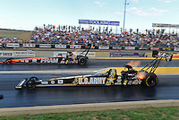 Jul, 20, 2012; Morrison, CO, USA: NHRA top fuel dragster driver Tony Schumacher (near) races alongside teammate Spencer Massey during qualifying for the Mile High Nationals at Bandimere Speedway. Mandatory Credit: Mark J. Rebilas-US PRESSWIRE
