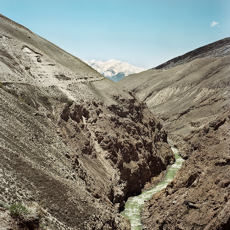 The Panj River flows through the Big Pamir mountains of the Wakhan Corridor, forming the border between Afghanistan and Tajikistan.