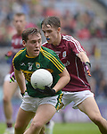 Kerry's Dara Moynbihan under pressure from Galways's Adam Quirke in the All-Ireland Minor final at Croke on Sunday.<br /> Photo: Don MacMonagle