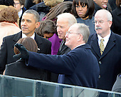 United States Senator Lamar Alexander (Republican of Kentucky), right middle, seems to be showing something to U.S. President Barack Obama, left, and Vice President Joe Biden, left center, following the public swearing-in ceremony at the U.S. Capitol in Washington, D.C. on Monday, January 21, 2013.  Looking on from right is U.S. Senate Sergeant at Arms Terrance W. Gainer..Credit: Ron Sachs / CNP.(RESTRICTION: NO New York or New Jersey Newspapers or newspapers within a 75 mile radius of New York City)