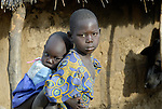 A displaced girl cares for her younger sister in an camp for the internally displaced in northern Uganda.