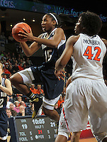 Notre Dame guard Lindsay Allen (15) shoots in front of Virginia forward Sarah Imovbioh (42) during the first half of an NCAA basketball game Sunday Jan. 12, 2014 in Charlottesville, VA. (Photo/The Daily Progress/Andrew Shurtleff)