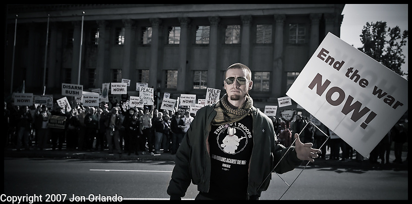 """Garett Reppenhagen was one of the first outspoken critics of the Iraq War while still serving in Iraq as a calvary sniper.  He was a co-founder of the blog """"fight to survive"""" and was photographed at an antiwar rally in Denver.  This is from a portrait series I am doing on Iraq War veterans who are resisting the war."""