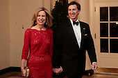 Liz Sherwood-Randall, White House coordinator for defense policy, left, and Jeffrey Randall arrive to a state dinner hosted by U.S. President Barack Obama and U.S. First Lady Michelle Obama in honor of French President Francois Hollande at the White House in Washington, D.C., U.S., on Tuesday, Feb. 11, 2014. Obama and Hollande said the U.S. and France are embarking on a new, elevated level of cooperation as they confront global security threats in Syria and Iran, deal with climate change and expand economic cooperation.<br /> Credit: Andrew Harrer / Pool via CNP