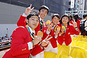 (L-R) Koji Yamamuro, Kenzo Shirai, Eri Tosaka, Sara Dosho (JPN), <br /> OCTOBER 7, 2016 :<br /> Japanese medalists of Rio 2016 Olympic and Paralympic Games wave to spectators during a parade from Ginza to Nihonbashi, Tokyo, Japan.<br /> (Photo by Yusuke Nakanishi/AFLO SPORT)