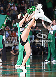 North Texas Mean Green cheerleaders do a high kick routine during the NCAA  basketball game between the Arkansas State Red Wolves and the University of North Texas Mean Green at the North Texas Coliseum,the Super Pit, in Denton, Texas. UNT defeated Arkansas State 83 to 64..