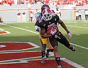 Wide receiver Jay Smith scores the first touchdown of the game moments after State receives the ball. NC State defeated Central Michigan 38-24 on Saturday, October 8, 2011 at Carter-Finley Stadium in Raleigh. Photo by Al Drago.
